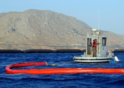 "080723-N-0780F-002 SOUDA BAY, Crete, Greece (July 23, 2008) An oil spill response team at U.S. Naval Support Activity Souda Bay deploys a ""Harbour Buster"" high-speed oil containment system during a drill to test procedures to contain and recover oil during a spill. (U.S. Navy photo by Mr. Paul Farley/Released)"