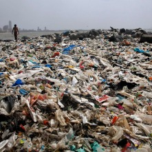 An Indian boy walks by the Arabian Sea coast piled with garbage, mostly plastic waste, in Mumbai, India, Friday, June 26, 2015. Several recent reports have highlighted India's worsening air quality and termed its capital New Delhi the worst polluted city in the country. In the last decade, along with India's economic boom and increasing prosperity, the output of garbage has also increased manifold. (AP Photo/Rajanish Kakade)